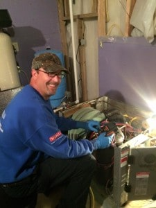 Technician Joe trouble shooting geothermal heat pumps with a smile